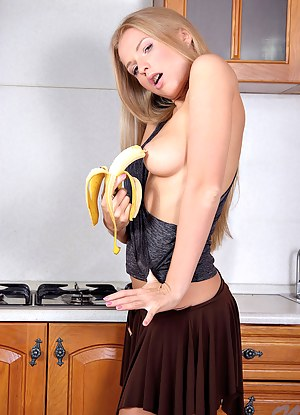 Horny chick strips and stroking her banana in her cunt then masturbates
