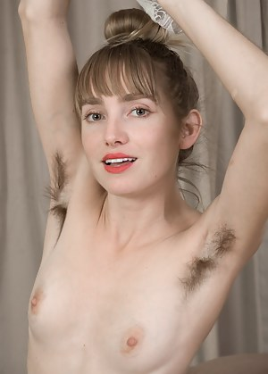 Rosy Heart lays in a sexy dress showing off her hairy legs. Her stockings cover her hairy pussy as she lays in her tiger bed. She strips naked, strokes her hairy pits, and puts on a wild show.