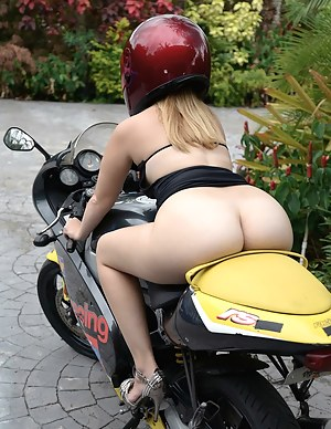 The owner of a cool bike can do with this babe whatever he wants to do. He is pushing cock into her sweet mouth and fucking her pussy.