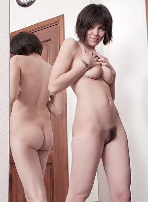 Kinky Sasha M checks out her own gorgeous natural body as she undresses slowly in front of the mirror.