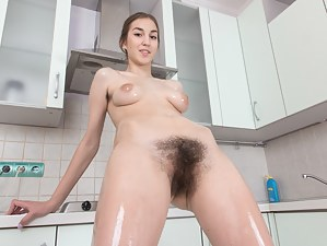 Halmia is in the kitchen and showing off her hairy pits and body. She puts on a wild strip show and covers her body in oil. Her breasts and ass are covered in oil nicely. Then she uses her hair dryer.