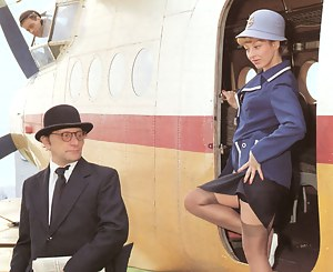 A retro flight attendant enjoys screwing a chap outdoors