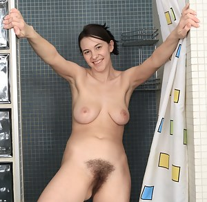 Busty nympho Claire cant wait to turn up the heat and play with her already moist hairy pussy in the shower. Soapy bubbles are her favorite.