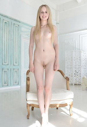 This sexy blonde teen reflects the sunlight off her pale white skin and her tight pussy is sparkling with beauty.