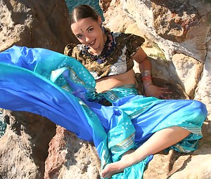Indian teen goddess teasing with her absolutely perfect body while wearing a blue scarf and a summer dress.