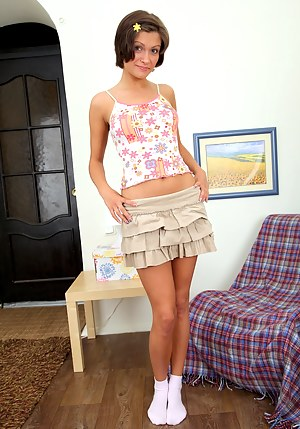 Short skirt teenage girl enjoys pleasuring herself a lot