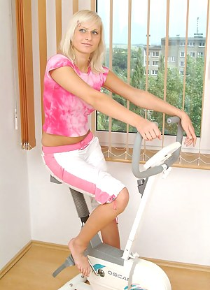 Rose is one silly teen she is playing on a stationary bike and gets topless and play with her tits