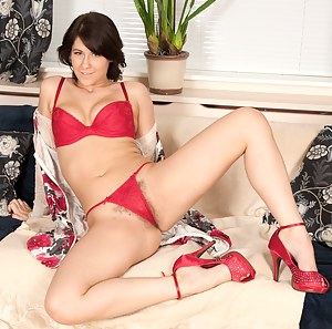 Jade strips out of her sexy red lingerie but likes to leave her sexy red heels on while getting kinky on the couch.