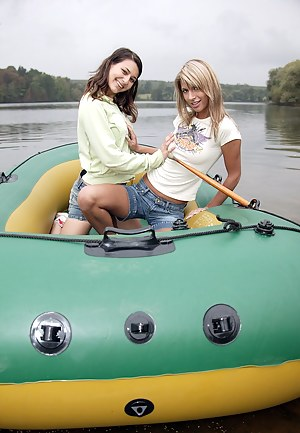 Two teenage girls toying eachother outdoor in a rubber boat
