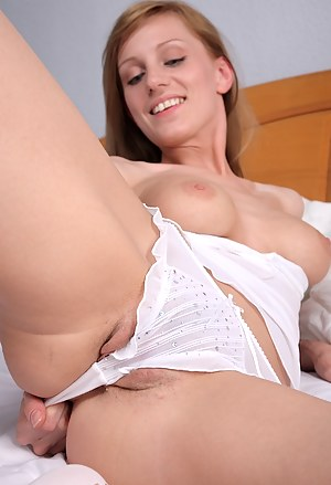 Olga loves shoving things in her pussy!