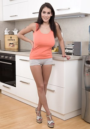 Mischel Lee is alone in her kitchen in her orange top and grey shorts. She shows off her hairy pussy early with her 42DDD breasts. She enjoys her body and then enjoys her hairy pussy with a banana.
