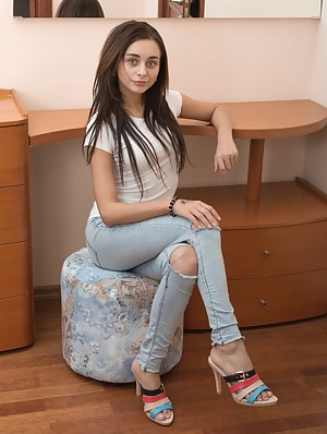 Dominika Sand strips off her blouse and denim shorts in her commode. She smiles as she spreads her legs and shows off her hairy bush. She puts on an elegant and sexy show, while showing off her body.