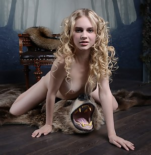 Petite blonde babe showing off her tight teen pussy on the back of her slain bear, because she loves the warm sensation.