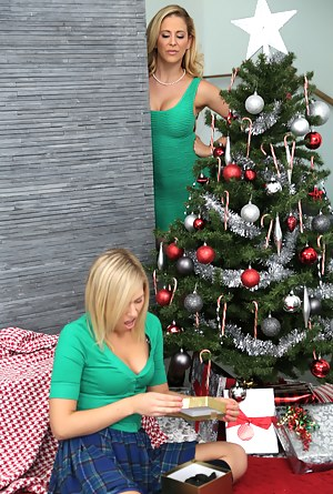 Juicy woman is getting fucked by her lovely girl under the Christmas tree. You will see the hottest lesbian tricks in this cool clip.