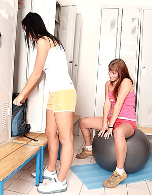 Two brunette lesbian teenagers toying after a sports game