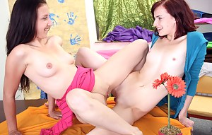Teenage cutie stroking her slippery snatch with her toes
