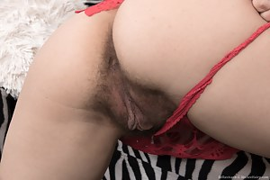 Bellavitana is playing around in her red blouse and denim shorts. She strips them off and shows her 5'2