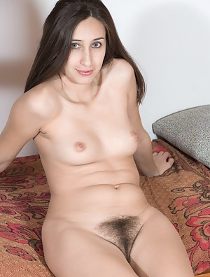 Vilma lays in her socks and lingerie on her mezzanine. She strips naked and spreads her legs to show her hairy pussy. Naked, she stretches, shows us her 25 year old body and looks pretty as ever there.