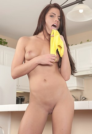 Stunning Adriana Chechik fingers her pussy on the counter.