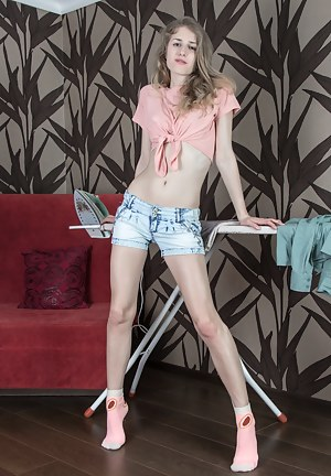 Arianna is all done ironing and is in her sexy denim shorts. Stripping naked, she gets on her favorite red chair and shows off her all-natural body. She slides her hands over her hairy pussy and delights us.
