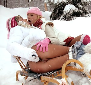 Two cute blonde lezzies toying outdoor in the cold snow