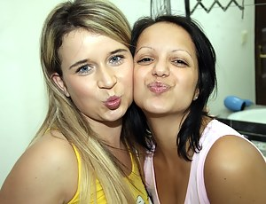 Two hot teen lesbians playing together in their bathroom